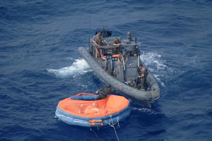 orange-raft-blue-water